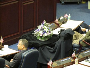 Black crepe covers the desk of Rep. Clay Ford.