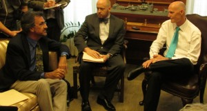Eckerd College Professor David Hastings, left, was among the scientists meeting with Gov. Rick Scott, right, and aide Noah Valenstein. Photo by Bruce Ritchie.