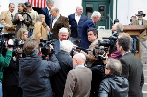 Bruce Ritchie, center left, covers former U. S. Sen. Bob Graham at the Florida Capitol in 2011. Photo by Margaret McPherson.