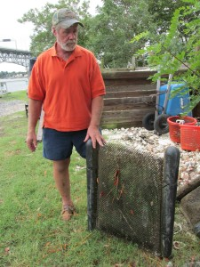 Tommy Leggett of the Chesapeake Bay Foundation shows floating oyster used in Virginia waterways. Photo by Bruce Ritchie.