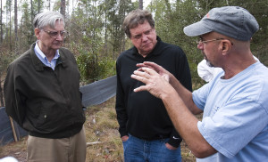 Harvard biologist Edward Wilson, left, and owner of the Nokuse Plantation property, M.C. Davis, listen to John Dindo, the director of the Dauphin Island Sea Lab, during a tour of the conservation area in Bruce, Fla. on Tuesday, Jan. 8, 2008.
